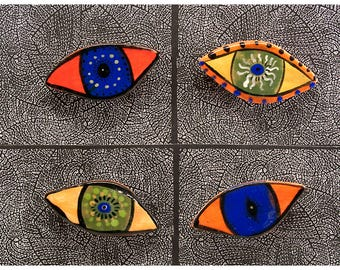 Four Small Eye Shaped Refrigerator Magnets by Jenny Mendes