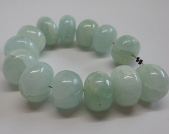 Natural spheroid shape blue-green semi translucent aquamarine large beads. Rondelles. Price for 13 beads. SPS621A