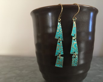 Stamped brass tiered drop earrings with blue patina.