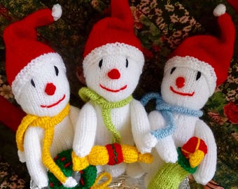 A trio of hand knitted Snowmen