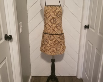 Bib style apron. Made very durable to last. Great for when cooking, baking, or grilling.