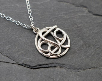 Miniature Leo cancer combined zodiac necklace sterling silver