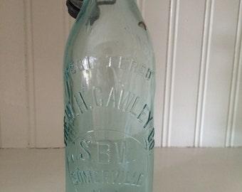 Antique W.H. Cawley Bottling Co. blob bottle