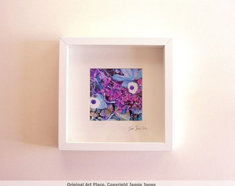 Small framed photo, 'Daisies and Pebbles' by Jessie Jones