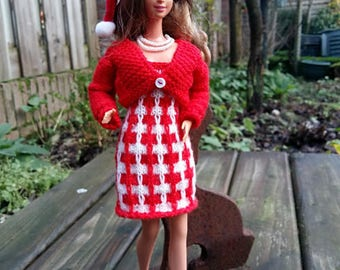 Christmasclothes for dolls like Barbie. Dress, cardigan, necklace and christmashat.