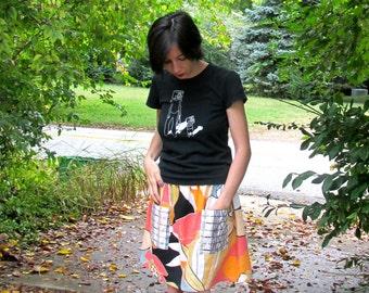 L. Mod skirt in vintage linen. Elastic waist. Roomy organza pockets with geometric print.