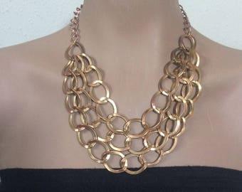 Vintage gold tone bib statement necklace.