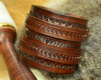 Engraved leather cuff.