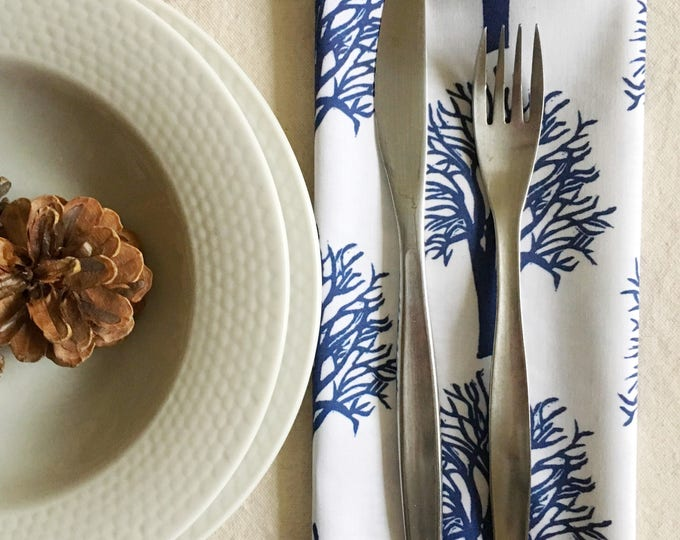 Set of four organic cotton dinner napkins, cherry trees in navy
