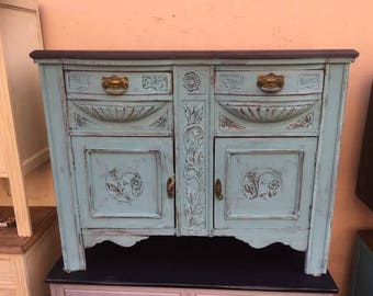 A Victorian Sideboard with bow fronted drawers.