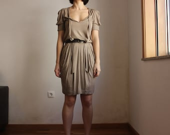 Beige pleated dress with brown belt