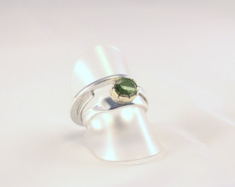 Ring of Silver and Peridot in a 14k gold setting