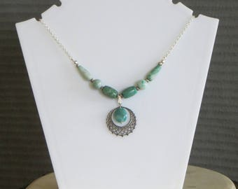 green stone and crescent necklace