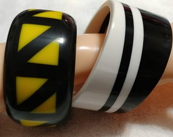 Vintage 2 pc. Black,White,and Yellow Striped and Chevron Lucite Bangle Bracelets