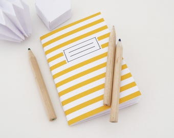 Mini A7 notebook with yellow and white stripes