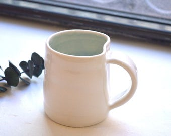 Aqua Blue mug with twist - Handmade wheel thrown porcelain pottery by Alison Ostergaard- READY TO SHIP