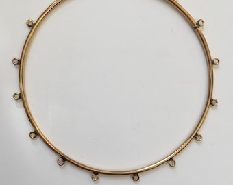 Bangle Bracelet in 14 karat Gold Filled. 2.5 inch diameter with 16 loops to attach dangles. 7 - 8 inch bracelet size.