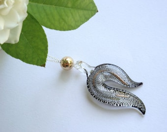Silver and gold, glass pendant