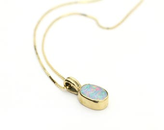 Genuine Opal Pendant in 14k Yellow Gold.  Approx. 1/2 CTTW