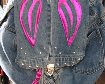 Jeans and neon pink leather backpack