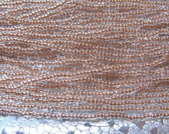 Seed Bead 11/0 Copper Lined Clear  about 1500 Beads