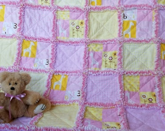 Pink and yellow rag quilt with giraffes, for baby girl
