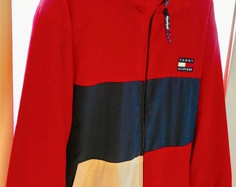 Vintage tommy Hilfiger lining jacket  in mint condition. size L-XL. really rare vintage item.