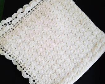 Crocheted white baby blanket