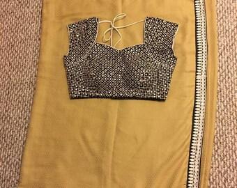 Beige Shiffon Saree with contrasting black work blouse