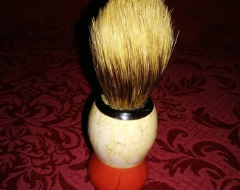 Vintage 1950's shaving brush. Red and white circular. Belonged to my best friends dad. He was a good man. I didn't get to meet him.