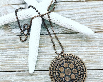 """Copper medallion pendant on 23"""" copper ball chain."""