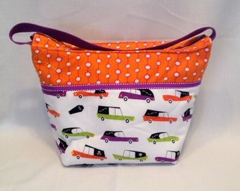 "LIP5- Lunch Bag: ""Driven to Eat"" washable insulated lunch bag with zippered front pocket and zippered top closure."