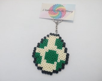 key pixel art in hama beads: super mario, yoshi egg