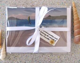 Hamilton Island greeting cards featuring paintings by Elena Parashko, gift pack of Catseye Beach, All Saints Chapel and Hamilton Island art