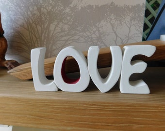 The word 'LOVE' for now, then and valentines