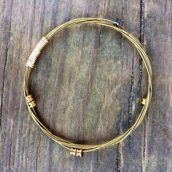 items similar to gold guitar string bracelet guitar string jewelry stacking bracelet bangle. Black Bedroom Furniture Sets. Home Design Ideas