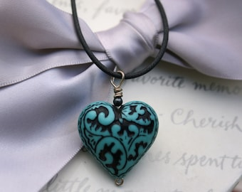 Paisley heart necklaces
