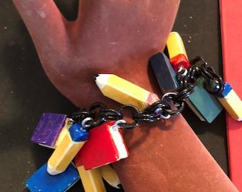 Artisan books & pencils bakelite bracelet