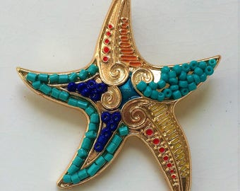 new stock gold tone metal blue beaded starfish pendant