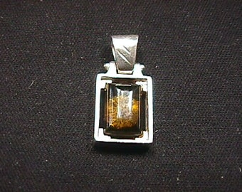 Vintage Sterling Silver Swinging Pendant with a Brown Stone in it