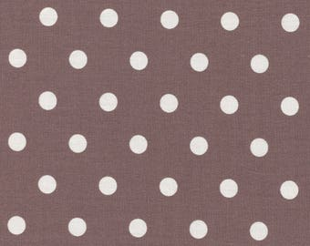 Cotton fabric printed with white polka dots on Brown background