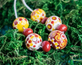 Mexican bead set_ball shaped_lampwork glass_set of nine_polka dot pattern_terracotta red_yellow ivory_dotted striped_multipurpose DIY kit