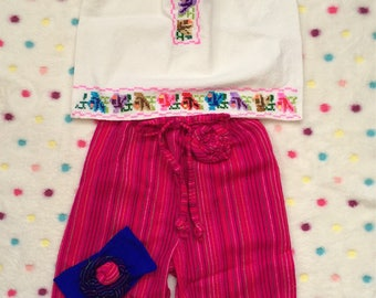 Folkloric traditional Mexican pants with a beautiful blouse embroidered by hand.