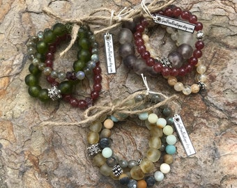 Handmade semiprecious and glass bead bracelets.