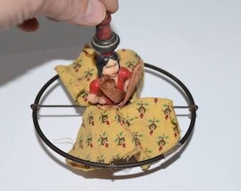 vintage spinner top toy Spanish dancer