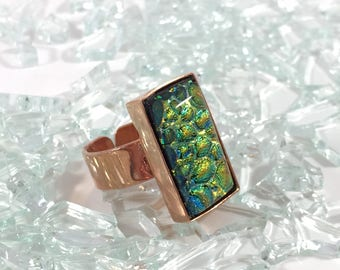 fused glass adjustable copper ring in a yellow, gold, and green dichroic sparkle