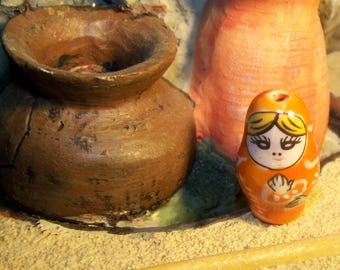 orange bead nesting doll matryoshka