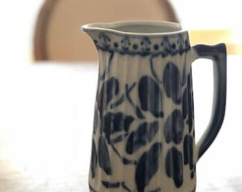 Blue and white pitcher made in brasil