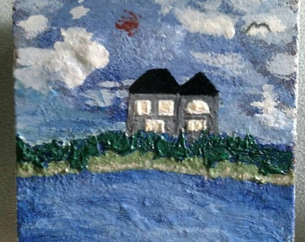 Acrylic painting of house on the water.