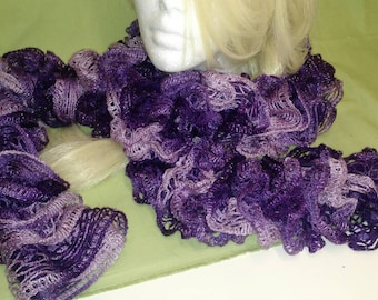 "Handmade ruffled, mesh lace scarf in purples.  Approximately 65"" long."